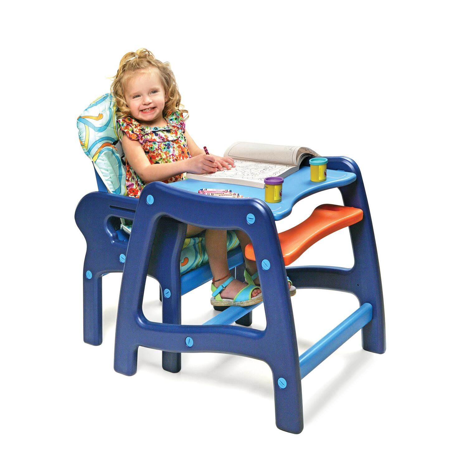 Child Sitting In Chair At Table