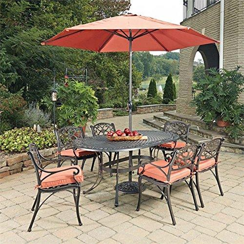 Home Styles Biscayne Rust Bronze Oval 9 Pc Outdoor Dining Table, 6 Arm Chairs with Cushions & Umbrella with Base