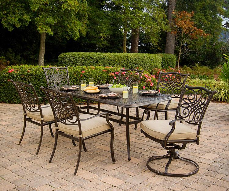Hanover Traditions 7-Piece Outdoor Dining Set of Four Dining Chairs, Two Swivel Chairs and a 38 x 72 in. Table