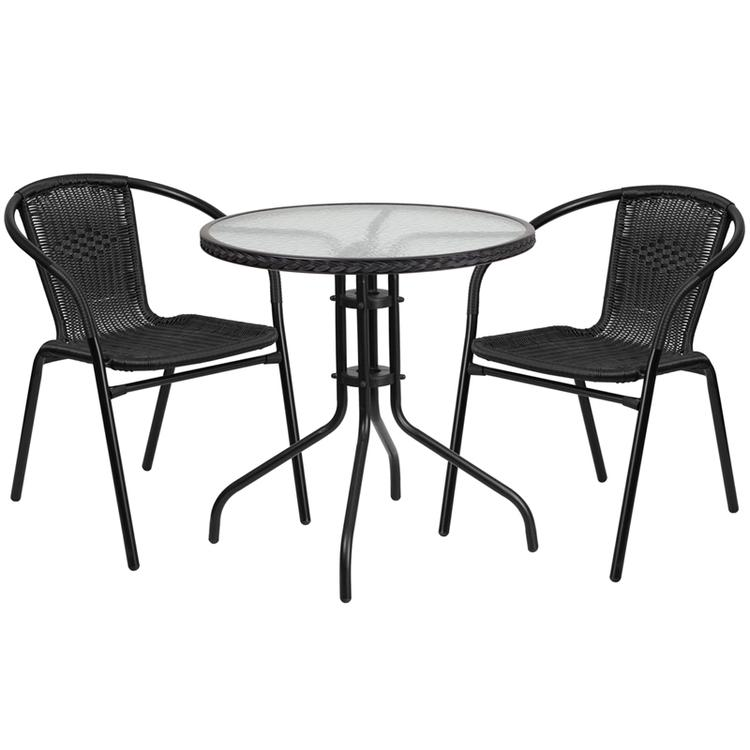 Round Glass Metal Table With Rattan Edging And Chairs